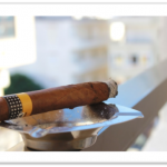 Gain style points and look like a pro by learning how to light a cigar the right way.
