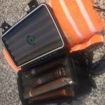 A portable humidor makes traveling with cigars a breeze.