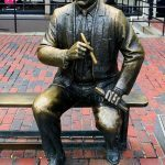 A statue of Red Auerbach holding a victory cigar