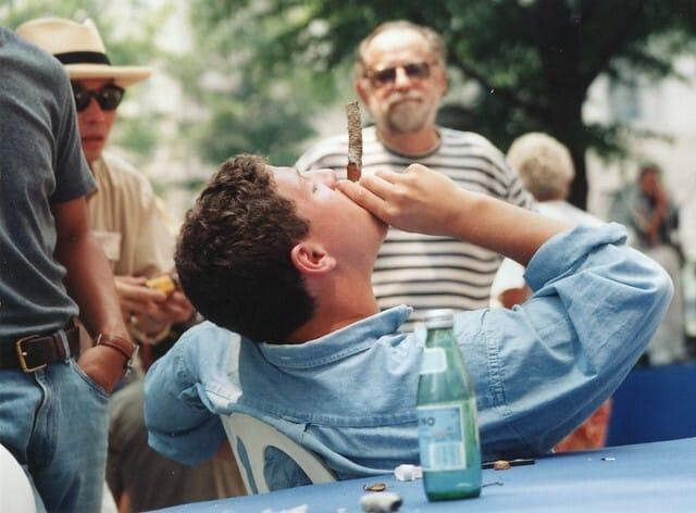 A man smoking during a cigar ritual