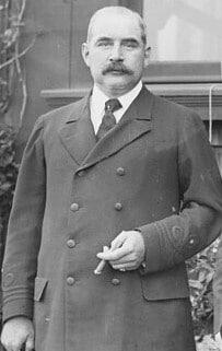 J.P. Morgan, the Zeus of Wall Street, posing with a cigar.