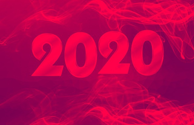 An image of 2020 and smoke trails