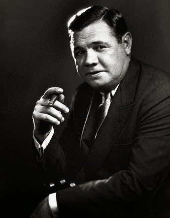 Babe Ruth pictured with a cigar