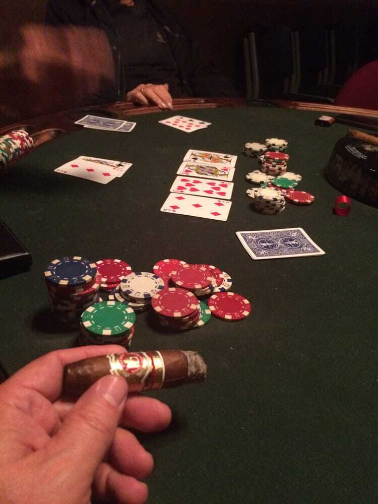 A game of poker, and cigars.