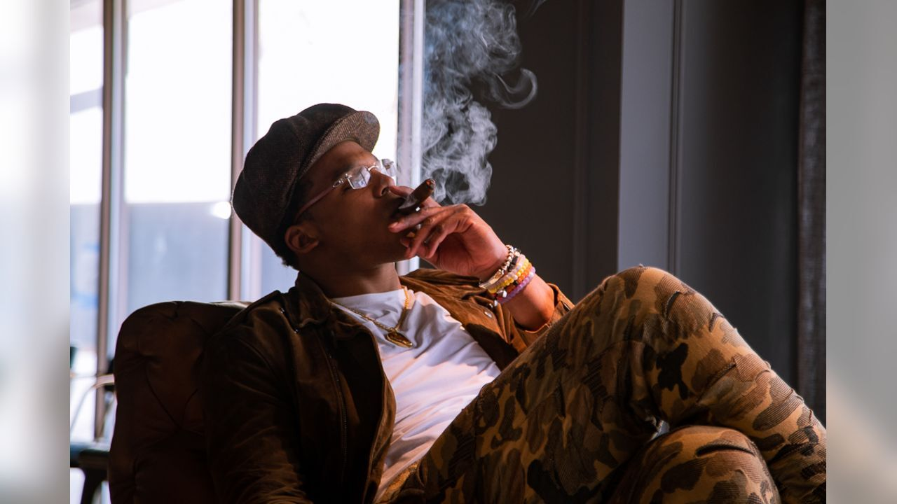 Cam Newton loves cigars so much, he started his own cigar club, a fitting lounge for any enthusiast.