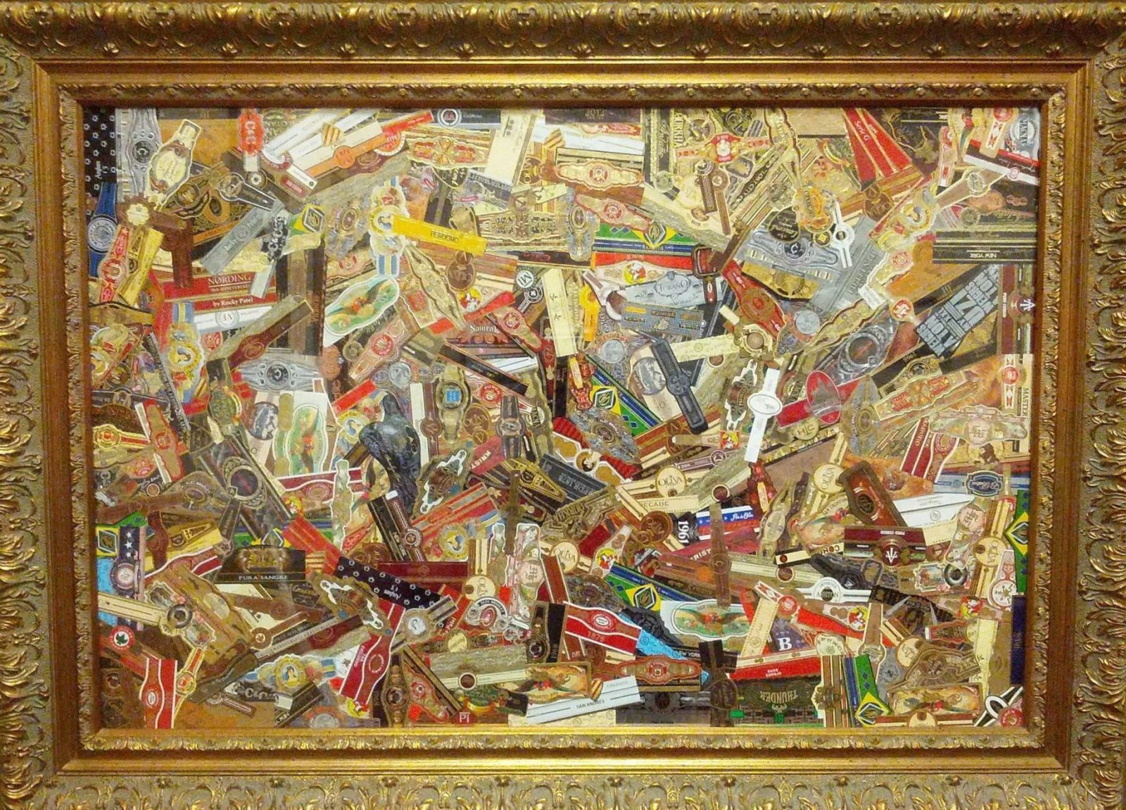 Framed art created by a variety of cigar bands.