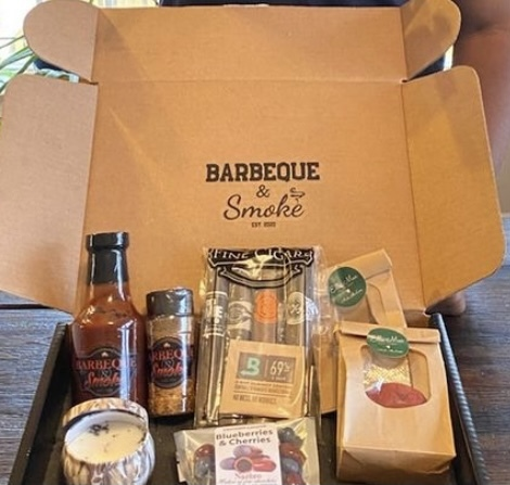 A monthly subscription box from Barbeque & Smoke, a venture company that offers a monthly sampling of items related to barbeque and cigars.