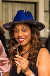 Robin Blue posing with a custom cigar poker