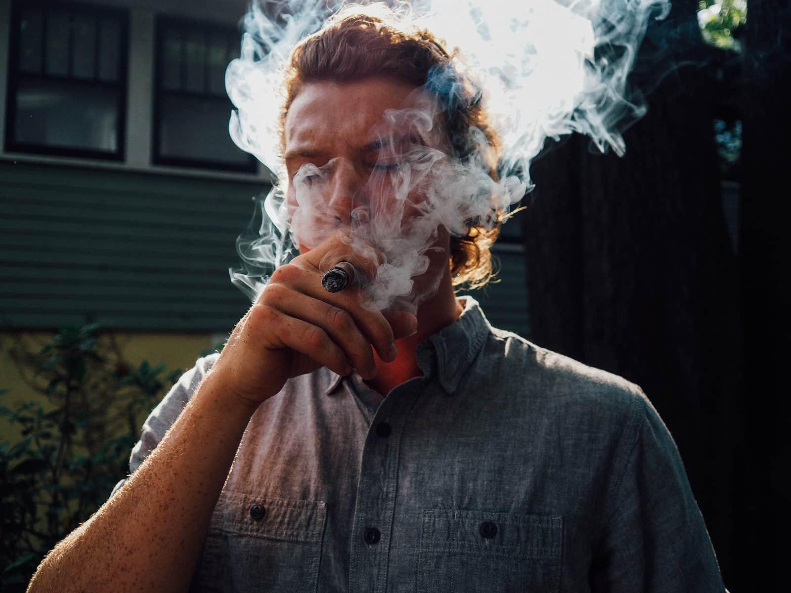 A man enjoying a good cigar