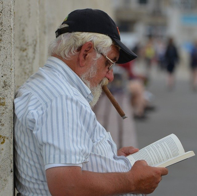A man enjoying cigar lifestyle and a good book