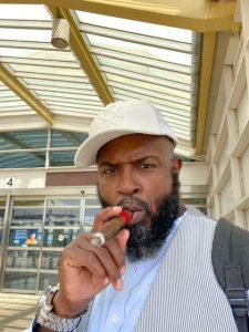 Yahya McClain smoking a cigar